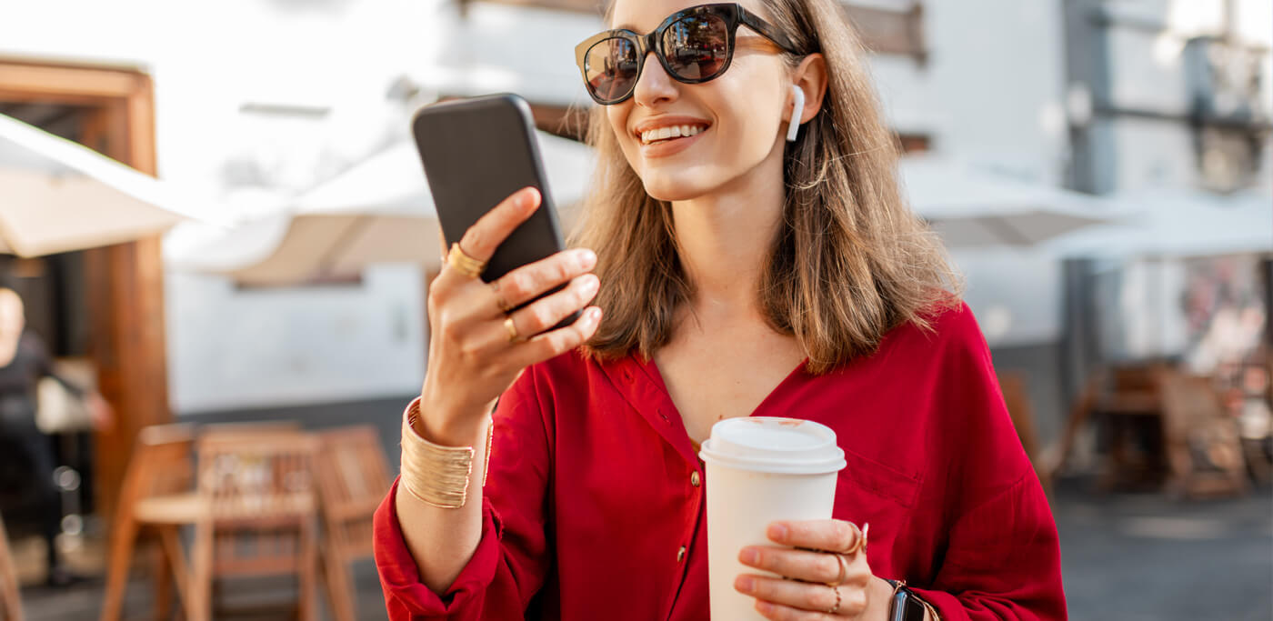 Happy women reading mobile phone