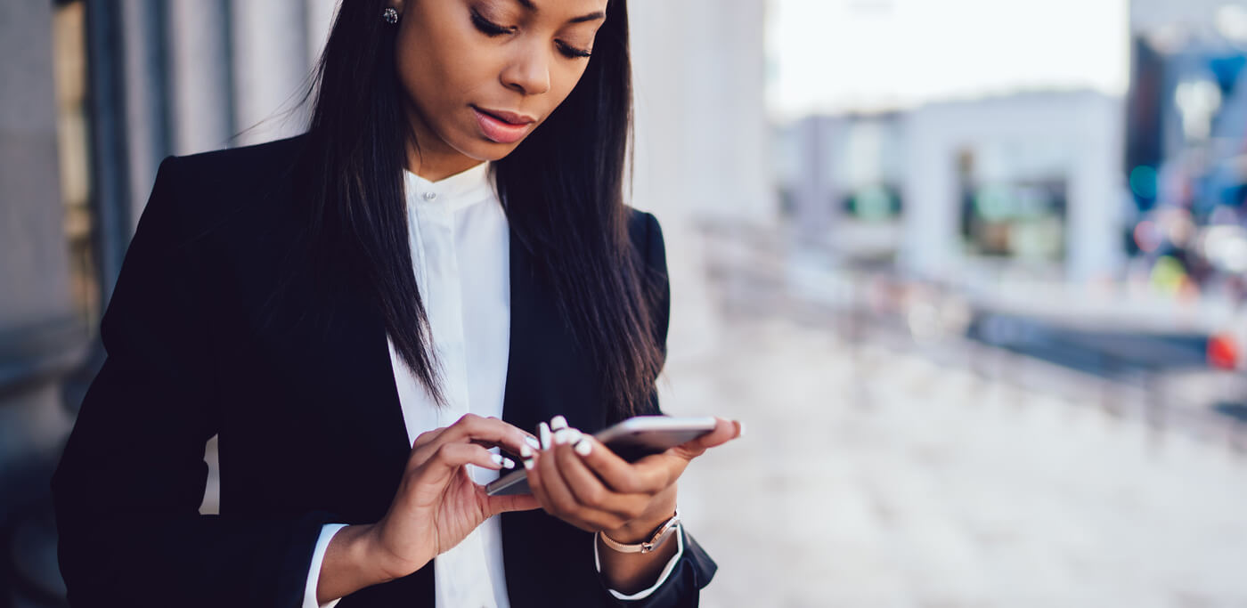 Women looking lost on mobile phone